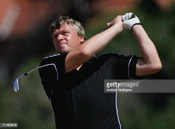 Warren Bladon of England watches a shot on the third hole during practice for The Open Championship at Royal Liverpool Golf Club on July 17, 2006 in...