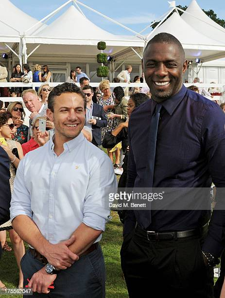 Warren Brown and Idris Elba attend day 2 of the Audi Polo Challenge at Coworth Park Polo Club on August 4 2013 in Ascot England