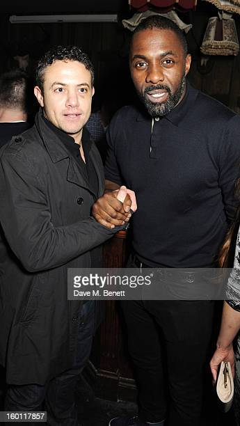Warren Brown and Idris Elba attend Love Liquor Nightclub on January 25 2013 in London
