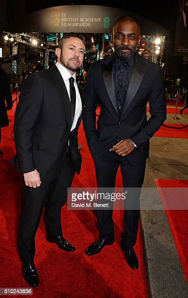 Warren Brown and Idris Elba attend the EE British Academy Film Awards at The Royal Opera House on February 14 2016 in London England