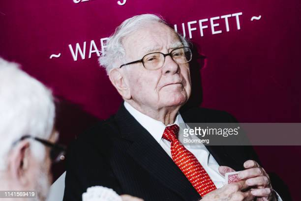 Warren Buffet, chairman and chief executive officer of Berkshire Hathaway Inc., plays bridge at an event on the sidelines of the Berkshire Hathaway...