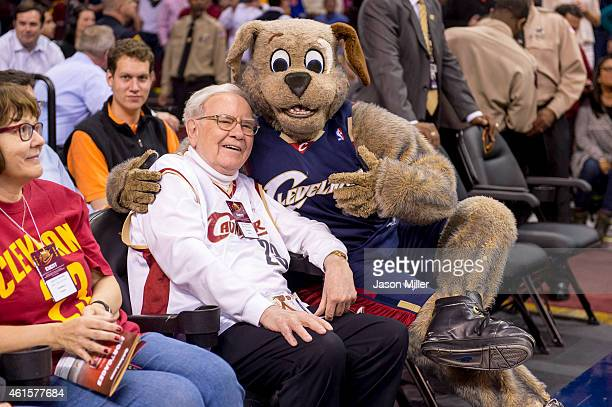 Warren Buffet goofs off with Cleveland Cavaliers mascot Moon Dog prior to the game against the Charlotte Hornets during the first half at Quicken...