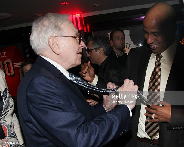 Warren Buffett and OG' Juan Perez attend the grand reopening of JayZ's 40/40 Club on January 18 2012 in New York City