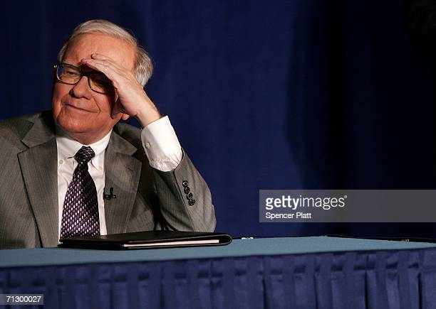 Warren Buffett attends a news conference with Bill and Melinda Gates June 26 2006 where Buffett spoke about his financial gift to the Bill and...
