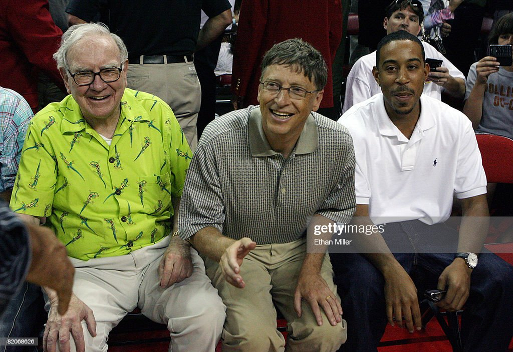 Warren Buffett, Bill Gates and rapper Ludacris sit courtside during the 2008 State Farm Basketball Challenge exhibition game between the USA Basketball Men's Senior National Team and the Canadian Senior Men's National Team at the Thomas & Mack Center July 25, 2008 in Las Vegas, Nevada.