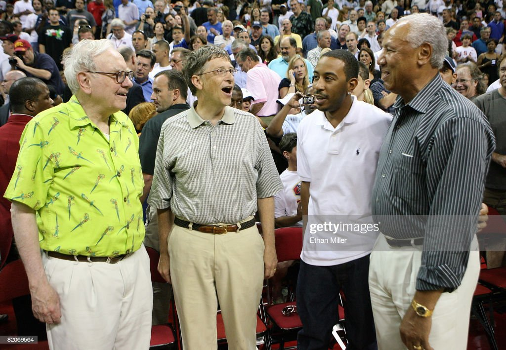 Warren Buffett, Bill Gates Ludacris and former NBA player Lenny Wilkens, talk courtside during the 2008 State Farm Basketball Challenge exhibition game between the USA Basketball Men's Senior National Team and the Canadian Senior Men's National Team at the Thomas & Mack Center July 25, 2008 in Las Vegas, Nevada.
