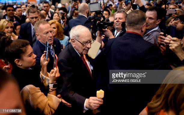 Warren Buffett CEO of Berkshire Hathaway is surrounded by press and fans as he arrives at the 2019 annual shareholders meeting in Omaha Nebraska May...