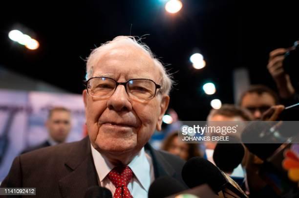 Warren Buffett , CEO of Berkshire Hathaway, speaks to the press as he arrives at the 2019 annual shareholders meeting in Omaha, Nebraska, May 4, 2019.