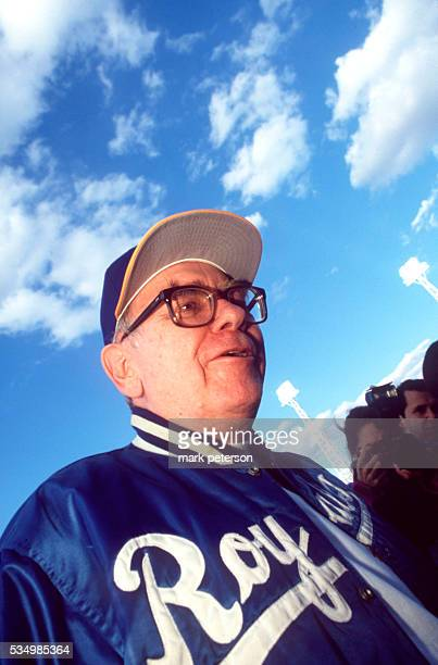 Warren Buffett CEO of Berkshire Hathaway wears a Royals jacket at the ballpark for an Omaha Royals baseball game Buffet is a minority owner of the...