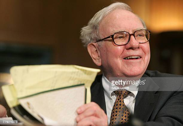 Warren Buffett chairman and CEO of Berkshire Hathaway prepares to testify before the Senate Finance Committee during a hearing on the Federal Estate...