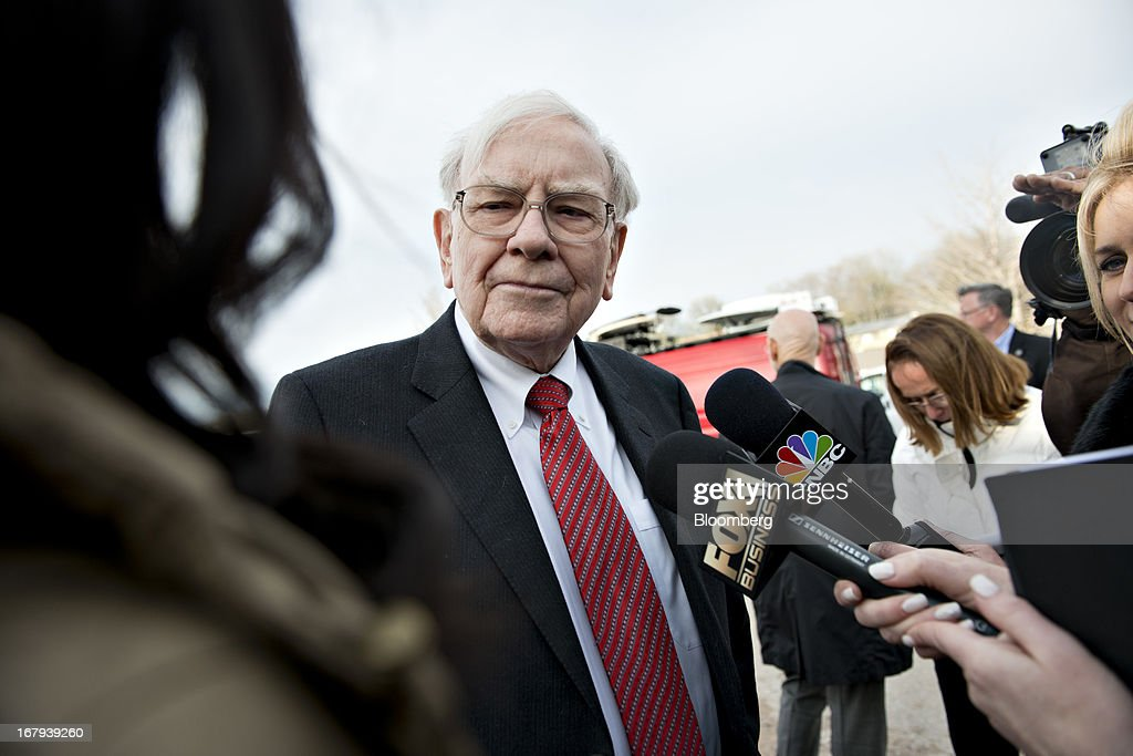 Warren Buffett, chairman and chief executive officer of Berkshire Hathaway Inc., listens while speaking to members of the media outside the Bridge Center in Omaha, Nebraska, U.S., on Thursday, May 2, 2013. Buffett said his eventual successor would probably be paid more than him to run the company. Photographer: Daniel Acker/Bloomberg via Getty Images