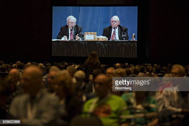 Warren Buffett chairman and chief executive officer of Berkshire Hathaway Inc left and Charlie Munger vice chairman of Berkshire Hathaway appear on a...
