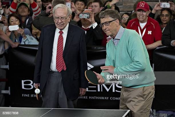 Warren Buffett chairman and chief executive officer of Berkshire Hathaway Inc left plays table tennis with Billionaire Bill Gates chairman and...