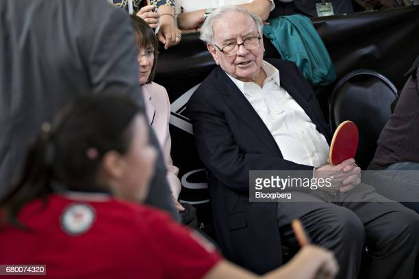 Warren Buffett chairman and chief executive officer of Berkshire Hathaway Inc watches as attendees play table tennis at an event on the sidelines the...