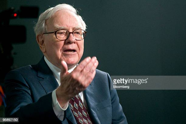 Warren Buffett chairman and chief executive officer of Berkshire Hathaway Inc speaks during a television interview before a special shareholders...