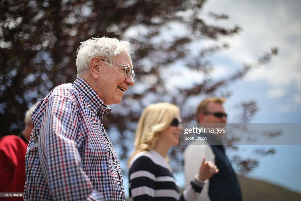Warren Buffett (L), chairman of Berkshire Hathaway Inc., chats with other guests at the Allen & Company Sun Valley Conference at the Sun Valley Resort on July 12, 2014 in Sun Valley, Idaho. Many of the world's wealthiest and most powerful executives from media, finance, and technology attend the week-long conference which is in its 32nd year.