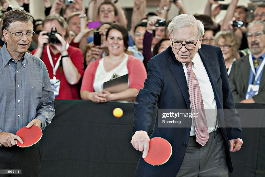 Warren Buffett, chairman of Berkshire Hathaway Inc. right, and Bill Gates, chairman of Microsoft Corp., play table tennis during an event at the annual shareholders meeting in Omaha, Nebraska, U.S., on Sunday, May 6, 2012. Berkshire Hathaway Inc. investment managers Todd Combs and Ted Weschler receive $1 million salaries and can earn more if their bets beat the Standard & Poor's 500 Index, Buffett said Sunday. Photographer: Daniel Acker/Bloomberg via Getty Images