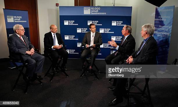 Warren Buffett, chief executive officer of Berkshire Hathaway Inc., from left, Lloyd Blankfein, chief executive officer of Goldman Sachs Group Inc.,...
