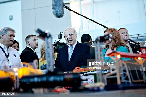 Warren Buffett chief executive officer of Berkshire Hathaway looks over a model train display as he tours the exhibition floor prior to the Berkshire...