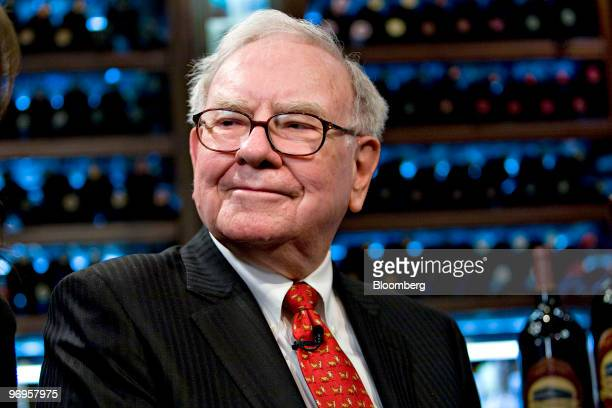Warren Buffett chief executive officer of Berkshire Hathaway pauses during a television interview in advance of a charity lunch with a group led by...