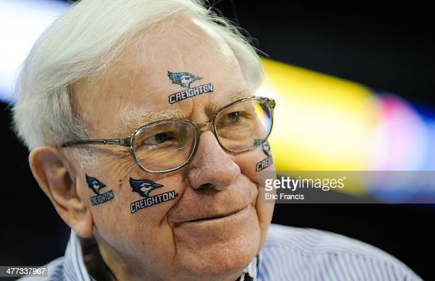 Warren Buffett of Berkshire Hathaway poses for pictures before the game between the Creighton Bluejays and the Providence Friars at CenturyLink...