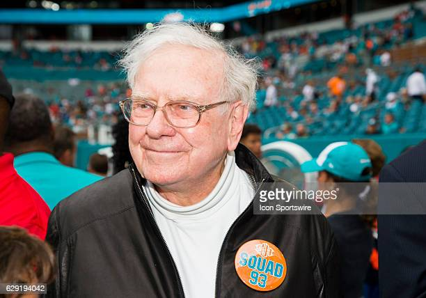 Warren Buffett smiles as he wears a Squad 93 button on the sidelines before the start of the NFL football game between the Arizona Cardinals and the...