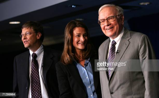 Warren Buffett stands with Bill and Melinda Gates June 26, 2006 at a news conference where Buffett spoke about his financial gift to the Bill and...