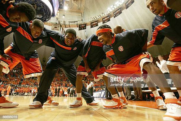 Warren Carter, Shaun Pruitt, Charles Jackson, Dee Brown and Brian Randle of the Illinois Fighting Illini huddle during introductions before a game...