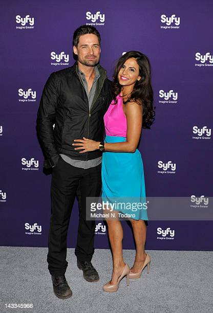 Warren Christie and Azita Ghanizada attend the Syfy 2012 Upfront event at the American Museum of Natural History on April 24 2012 in New York City
