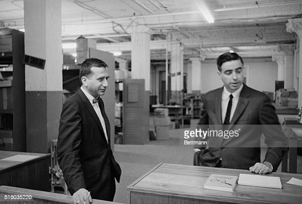 Warren Commission investigators David Belin and Howard Willens talk with a reporter at the Texas School Book Depository regarding the investigation...