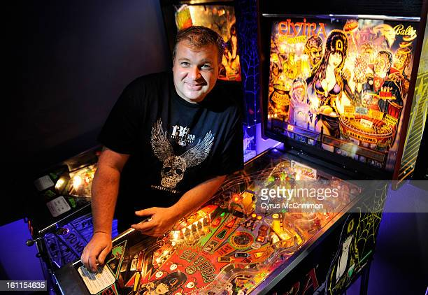 Warren Conard owner of the 13th Floor Haunted House with several of his pinball machines from his collection He was at his Denver office with two pin...