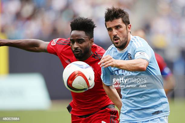 Warren Creavalle of Toronto FC battles for the ball with David Villa of New York City FC during the MLS match between Toronto FC and New York City at...
