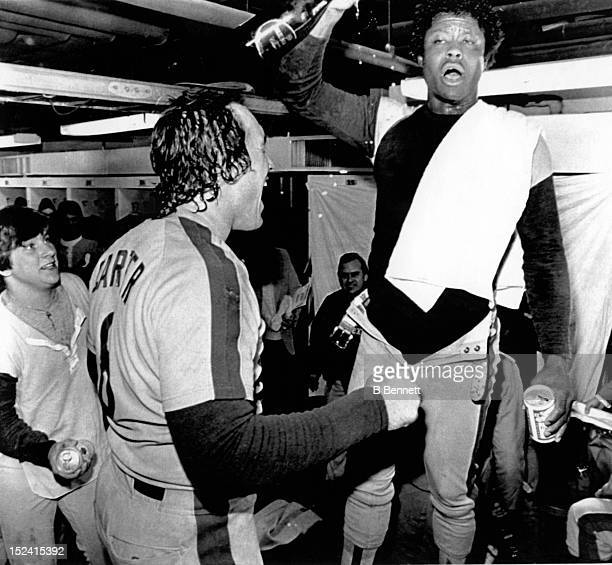 Warren Cromartie and catcher Gary Carter of the Montreal Expos celebrate in the locker room after making the playoffs after their game with the New...