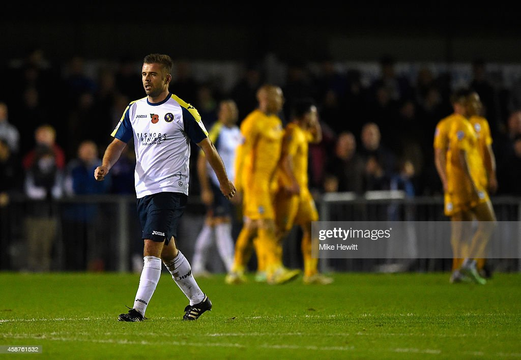 Warren Cummings of Havant leaves the pitch after being shown the red card during the FA Cup First Round match between Havant & Waterlooville FC and Preston North End on November 10, 2014 in Havant, England.