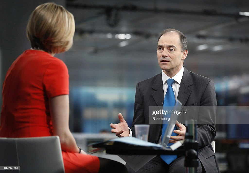 Warren East, chief executive officer of ARM Holdings Plc, right, gestures as he speaks during a Bloomberg Television interview in London, U.K., on Tuesday, Feb. 5, 2013. ARM Holdings Plc, whose chip designs power Apple Inc.'s iPhone and iPad, reported fourth-quarter sales that rose more than analysts predicted as demand for smartphones and tablets surged. Photographer: Simon Dawson/Bloomberg via Getty Images