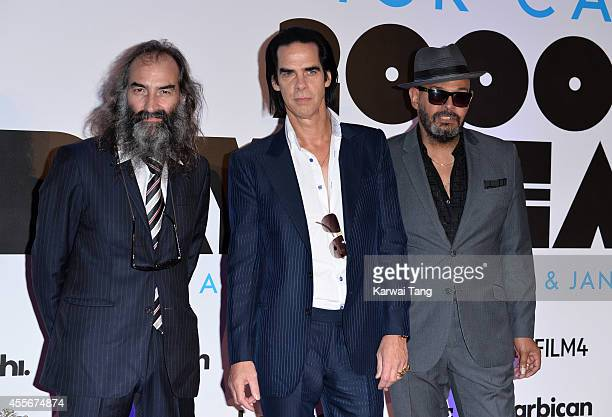 """Warren Ellis, Nick Cave and Barry Adamson from the rock band 'Nick Cave and the Bad Seeds' attend the """"20,000 Days on Earth"""" screening at Barbican..."""