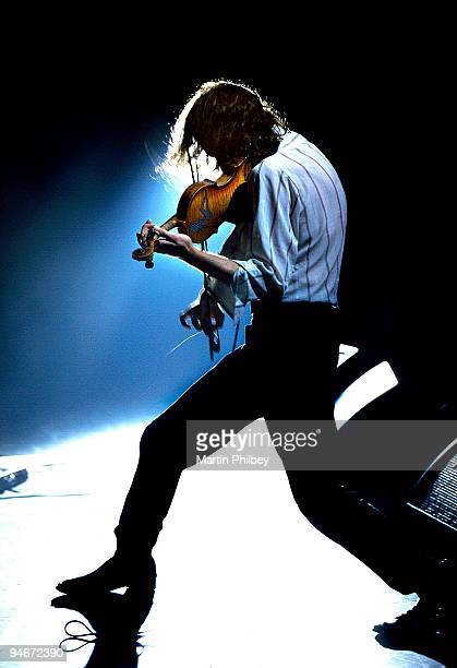 Warren Ellis of The Dirty Three performs on stage at the Forum Theatre in 1999 in Melbourne, Australia.