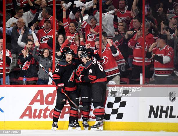 Warren Foegele celebrates with Sebastian Aho and Teuvo Teravainen of the Carolina Hurricanes after scoring a goal against the Washington...
