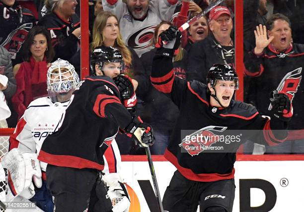 Warren Foegele of the Carolina Hurricanes celebrates after scoring a goal against the Washington Capitals on an assist by Justin Faulk during the...