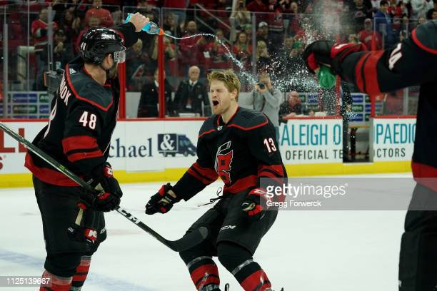 Warren Foegele of the Carolina Hurricanes celebrates during the team Storm Surge following a victory over the Edmonton Oilers during an NHL game on...