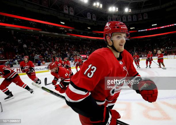 Warren Foegele of the Carolina Hurricanes celebrates with teammates doing a storm surge following a victory over the Toronto Maple Leafs during an...