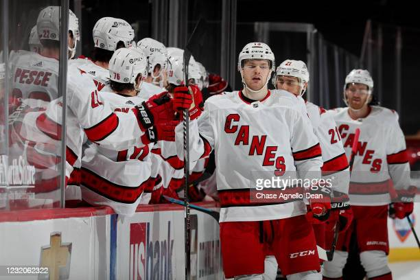 Warren Foegele of the Carolina Hurricanes celebrates with teammates after scoring a goal in the third period against the Chicago Blackhawks at the...