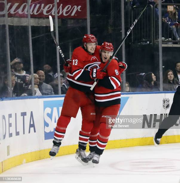 Warren Foegele of the Carolina Hurricanes scores the game winning goal at 643 of the third period against the New York Rangers and is joined by Saku...