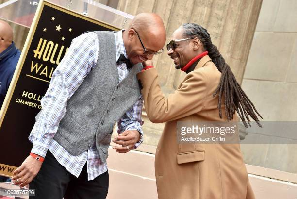 Warren G and Snoop Dogg attend the ceremony honoring Snoop Dogg with star on the Hollywood Walk of Fame on November 19 2018 in Hollywood California