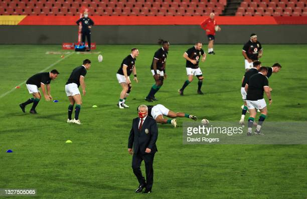 Warren Gatland, Head Coach of The British & Irish Lions wears a face mask as he leaves the pitch after the warm up prior to the Cell C Sharks v...