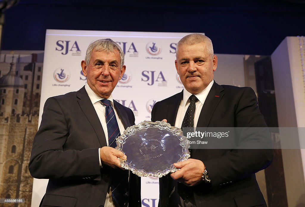 Warren Gatland receives the Team of the Year Award from Sir Ian McGeechan during the SJA British Sports Awards at Tower of London on December 12, 2013 in London, England.