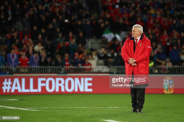 Warren Gatland the head coach of the Lions looks on as his team warm up prior to kickoff during the first test match between the New Zealand All...