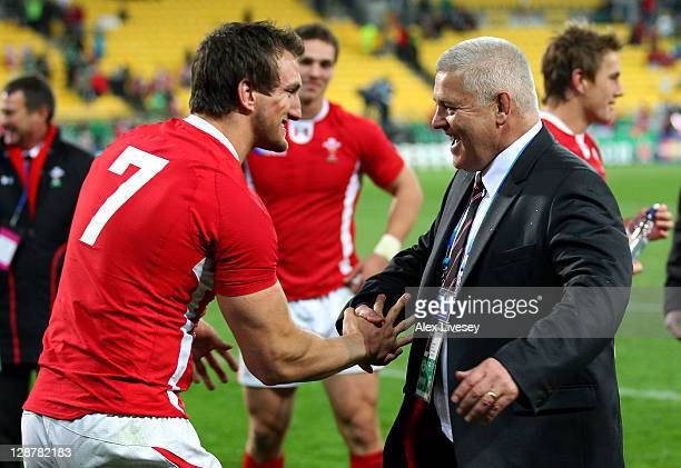 Warren Gatland the head coach of Wales celebrates with his captain Sam Warburton of Wales following their team's 2210 victory during quarter final...