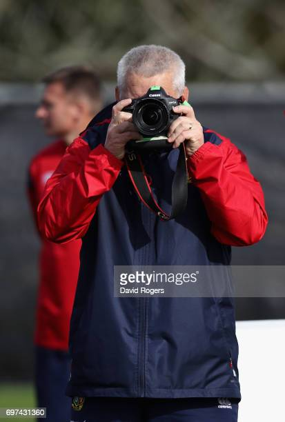 Warren Gatland the Lions head coach takes photographs of the photographers during the British Irish Lions training session at Beetham Park on June 19...