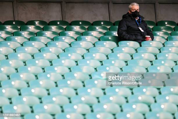 Warren Gatland watches from the empty stands ahead of leading the Lions Rugby tour during the Guinness Six Nations match between England and France...